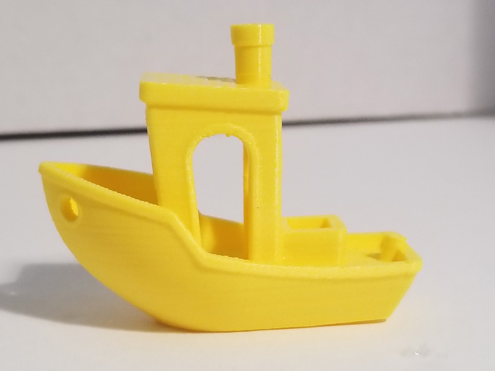 Photo: Yellow benchi tugboat with printer issues fixed. Side view.