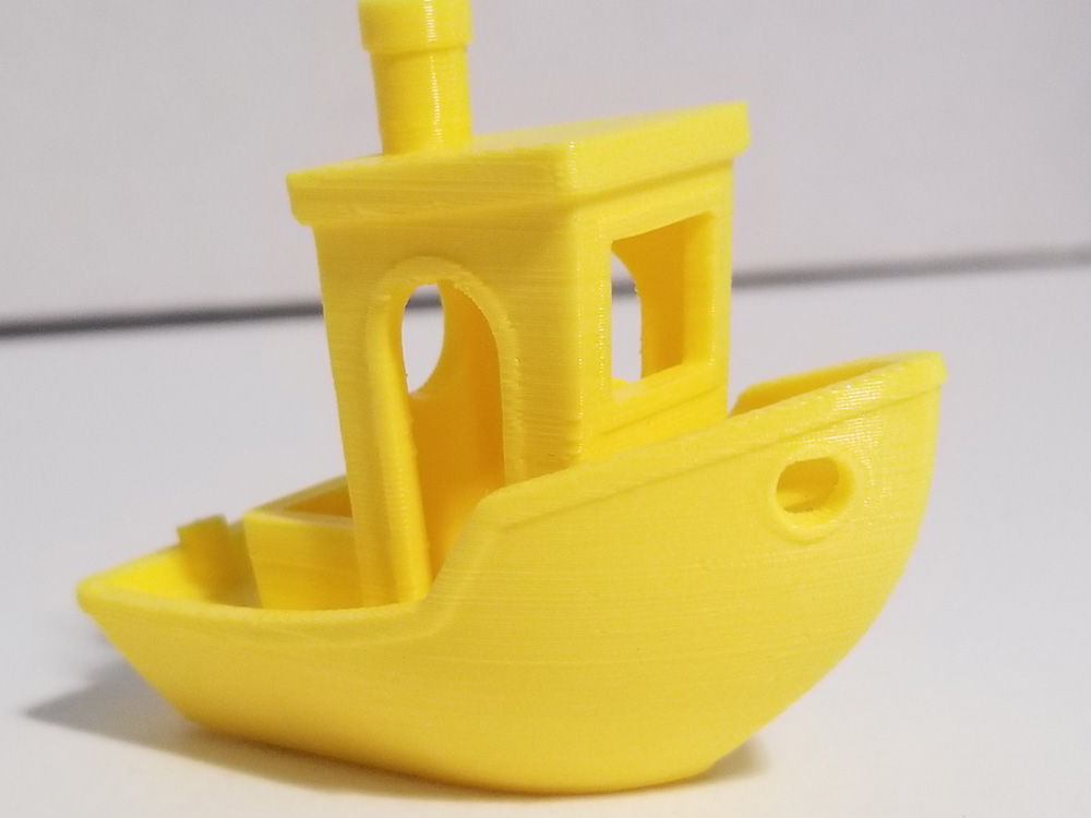 "Photo: Yellow ""benchi"" tugboat with printer issues fixed. Side view."