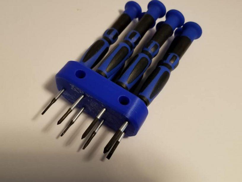 3D printout with blue set of jeweler screwdrivers.