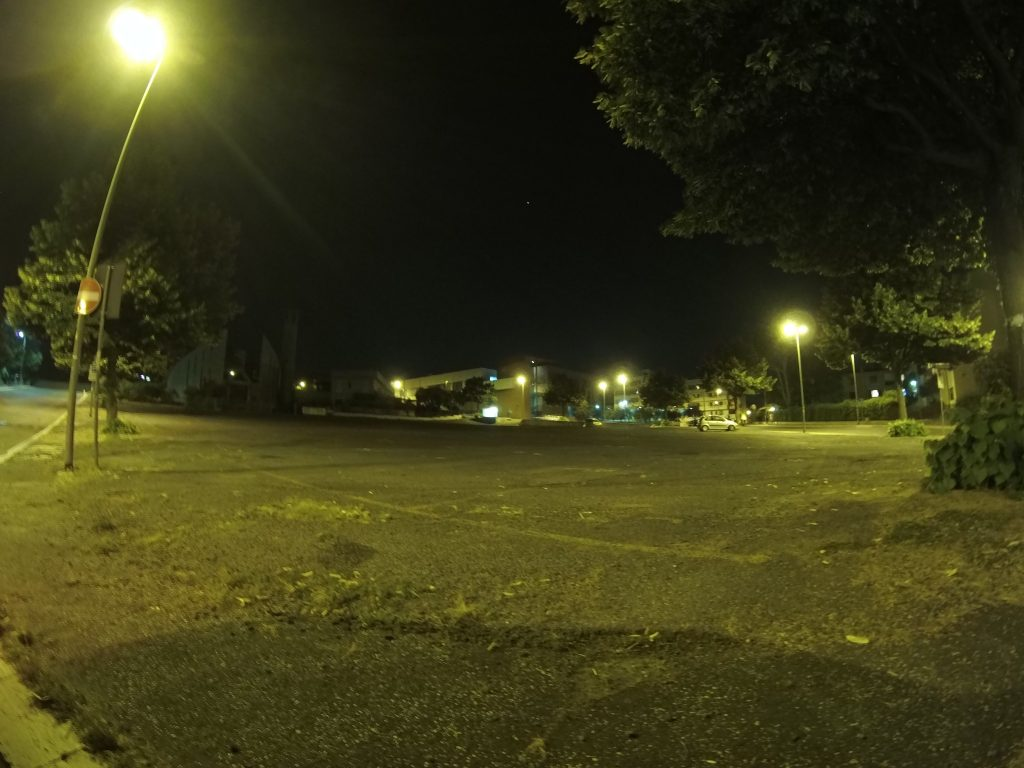 Photo of empty parking lot after dark.