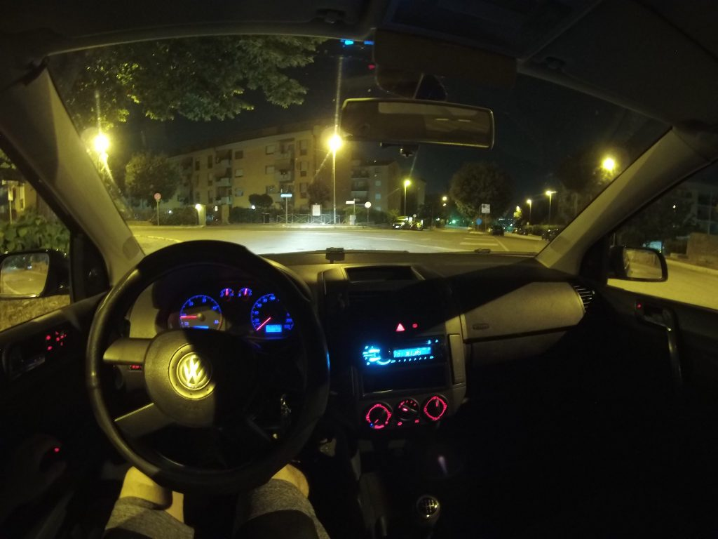 Photo taken from inside car with car control lights and street lights.