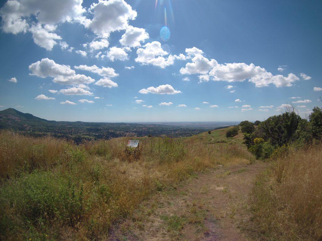 Photo of hilly landscape under bright blue sky.