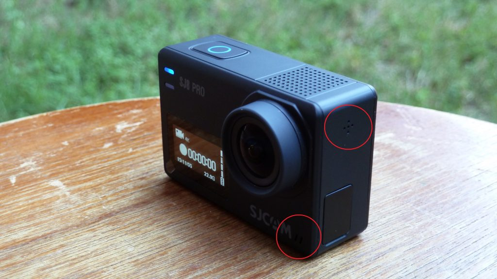 Photo of the SJ8 Pro with the dual microphones circled.