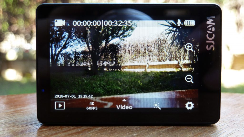 Photo of SJ8 Pro with the touch screen display and menu.