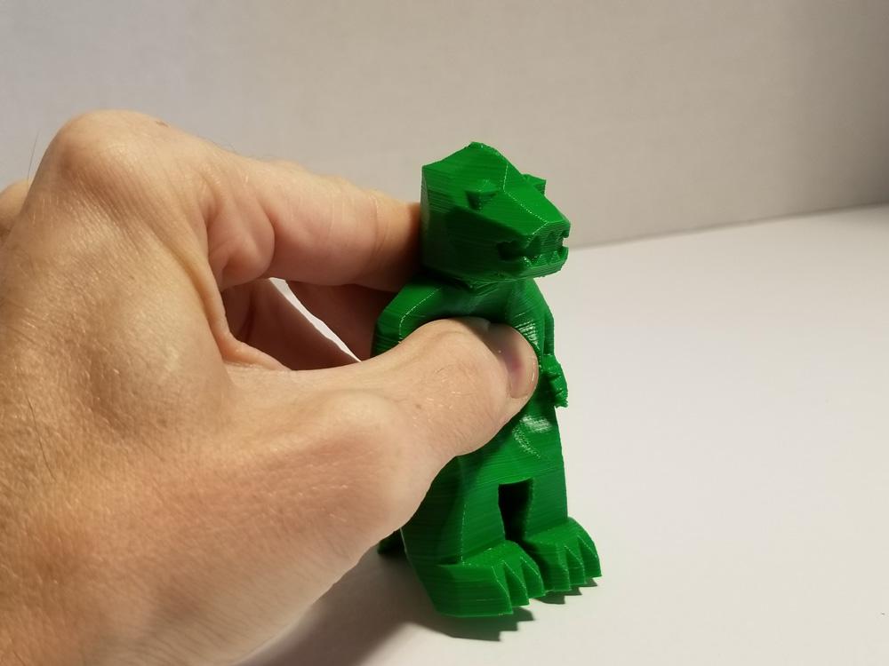 Tevo Michelangelo 3D Printer -- TPU filament -- green Godzilla -- being held.