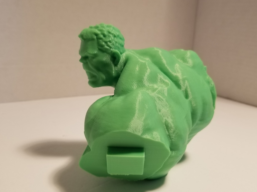 Photo of green 3D printout of Hulk's head and upper body - back.